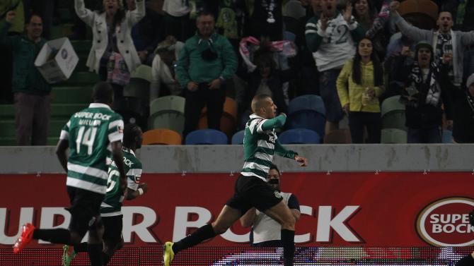 Sporting's Islam Slimani celebrates his goal against Porto during their Portuguese premier league soccer match at Alvalade stadium in Lisbon