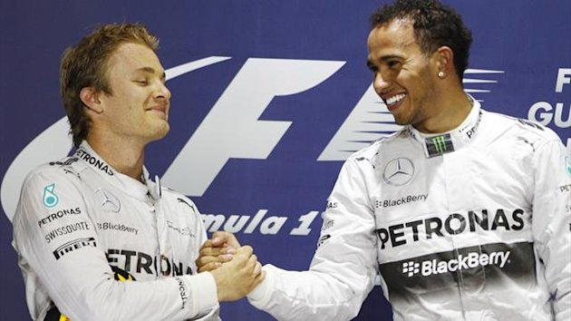 Mercedes Formula One driver Lewis Hamilton of Britain (r) with team-mate Nico Rosberg