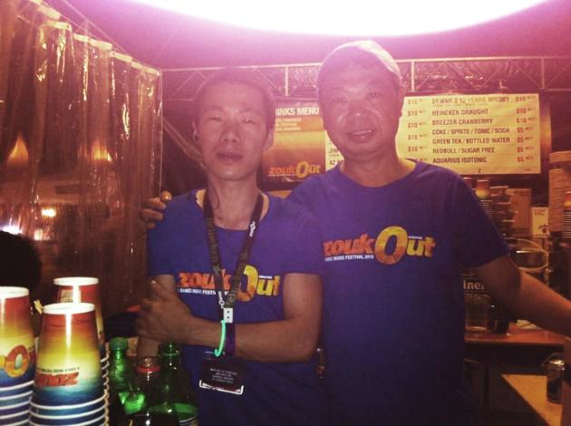 These two guys are selling alcohol at ZoukOut. (Yahoo! photo/ Gail Chai)