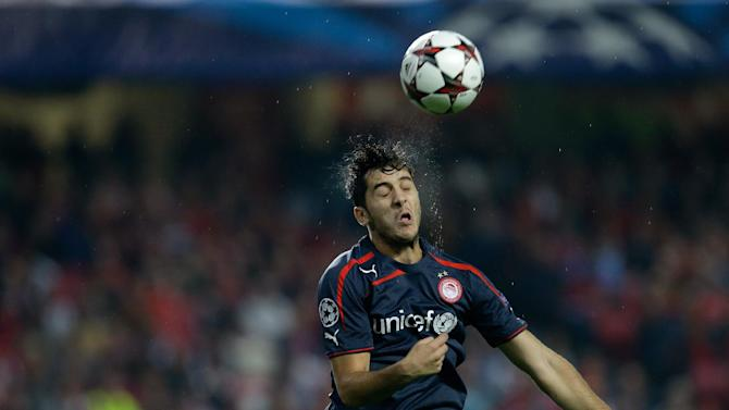 Olympiacos' Kostas Manolas heads the ball during the Champions League group C soccer match between SL Benfica and Olympiacos FC in Lisbon, Wednesday, Oct. 23, 2013