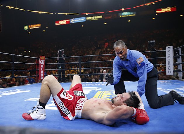 Referee Kenny Bayless gives a 10 count to Robert Guerrero after Guerrero was knocked down by Keith Thurman in a boxing match, Saturday, March 7, 2015, in Las Vegas. Thurman won by unanimous decision. (AP Photo/Eric Jamison)