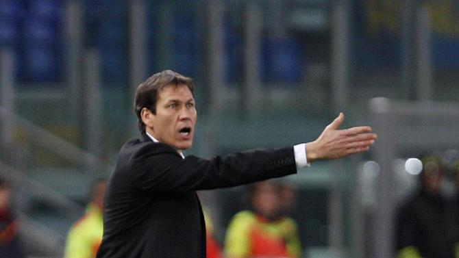 AS Roma coach Rudi Garcia, of France, shouts directions to his players during a Serie A soccer match between AS Roma and Sampdoria, at Rome's Olympic stadium, Sunday, Feb. 16, 2014