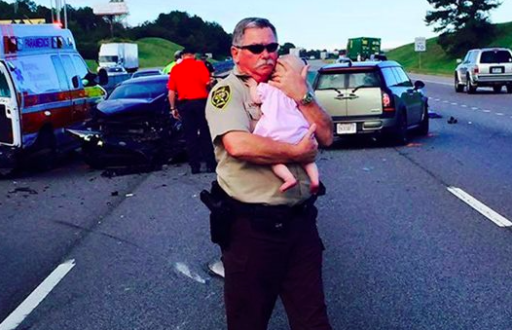 Police Officer Comforting A Baby After Car Crash Will Melt Your Heart