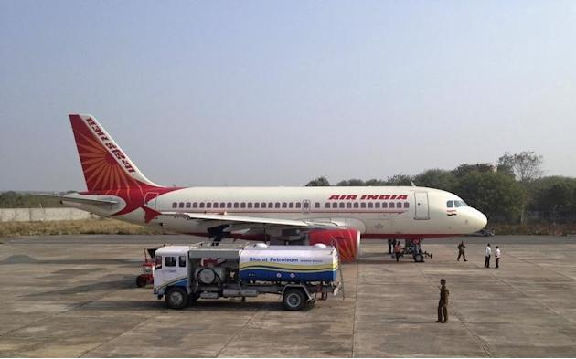 A Bharat Petroleum refuelling vehicle sits on the tarmac next to an Air India A320 aircraft as it refuels the plane with jet fuel in Gwalior