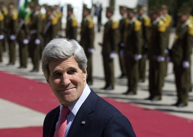 US Secretary of State John Kerry attends a ceremony at the Palestinian Authority headquarters in the West Bank city of Ramallah, on March 21, 2013. Palestinian president Mahmud Abbas will meet Kerry for talks on Sunday in the Jordanian capital Amman, a Palestinian official has told AFP