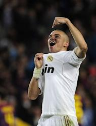 "Real Madrid's defender Pepe celebrates after winning the Spanish League ""El Clasico"" football match against Barcelona at the Camp Nou stadium in Barcelona. Real Madrid won 2-1"