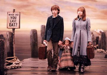 Klaus ( Liam Aiken ), Violet ( Emily Browning ), and Sunny ( Kara Hoffman /Shelby Hoffman ) Baudelaire in Paramount Pictures' Lemony Snicket's A Series of Unfortunate Events