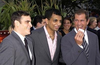 Joaquin Phoenix , M. Night Shyamalan and Mel Gibson at the New York premiere of Touchstone's Signs