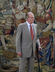 File - In this July 19, 2011 file photo Spain's King Juan Carlos, waits before a meeting at the Zarzuela Palace, in Madrid. Spain's King Juan Carlos has successfully undergone hip replacement surgery to repair minor damage related to arthritis worsened by a fall, his fourth operation in less than two years, royal palace officials said Saturday April 14, 2012. Leading newspaper El Pais reported on its website that the king had been on an elephant hunting trip when the fall occurred, but the palace declined to comment, saying the visit was a private matter. This is not the first time the aging monarch's love of hunting has caused concern. In October 2006, a Russian governor launched an inquiry into reports that Juan Carlos had shot and killed a bear while on holiday near Moscow. (AP Photo/Daniel Ochoa de Olza, File)