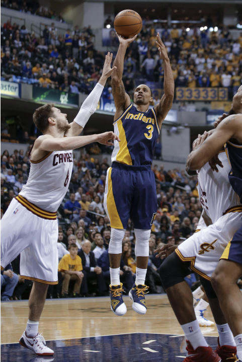 Indiana Pacers guard George Hill (3) shoots over Cleveland Cavaliers guard Matthew Dellavedova (8) during the second half of an NBA basketball game in Indianapolis, Friday, Feb. 27, 2015. The Pacers w
