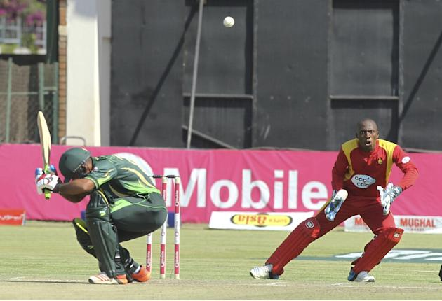 Zimbabwean wicketkeeper Brian Chari, right, keeps his eyes on the ball as Pakistan batsman Mommad Hafeez avoids during the One Day International Cricket match between Zimbabwe and Pakistan in Harare,