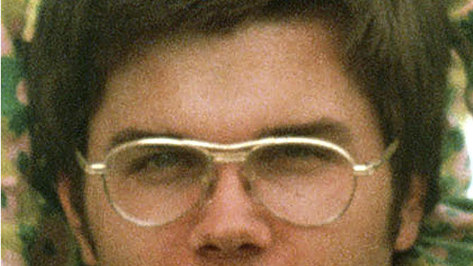 FILE - In this 1975 file photo, Mark David Chapman is seen at Fort Chaffee near Fort Smith, Ark. New York corrections officials say Chapman, 57, John Lennon's killer, was denied release from prison in his seventh appearance before the state Department of Corrections three-member board after a hearing Wednesday, Aug. 22, 2012. (AP Photo/Greg Lyuan, File)