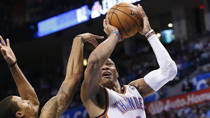 Oklahoma City Thunder guard Russell Westbrook (0) shoots in front of Indiana Pacers guard George Hill (3) in the second quarter of an NBA basketball game in Oklahoma City, Sunday, Dec. 8, 2013