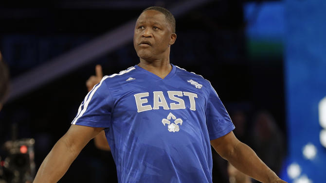 Former NBA player Dominique Wilkins watches his shot during the skills competition at the NBA All Star basketball game, Saturday, Feb. 15, 2014, in New Orleans. (AP Photo/Gerald Herbert)
