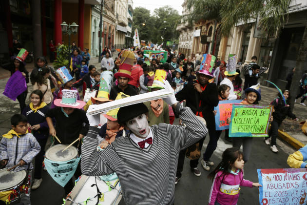 A mime joins a protest against child abuse in Asuncion, Paraguay, Saturday, May 30, 2015. According to the Health Ministry, most of the almost 700 cases of pregnancy in girls between the ages of 10 an