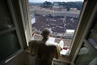 """Pope Benedict XVI leads the Angelus prayer from the window of his appartments on February 24, 2013 at the Vatican. He delivered an emotional last Sunday prayer in St Peter's Square, saying God had told him to devote himself to quiet contemplation but assuring he would not """"abandon"""" the Church"""