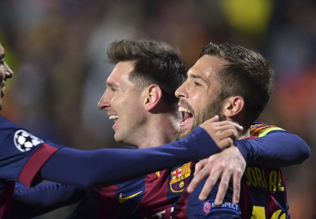 Barcelona's Messi celebrates with team mates after scoring a goal against APOEL Nicosia during their Champions League Group F soccer match in...