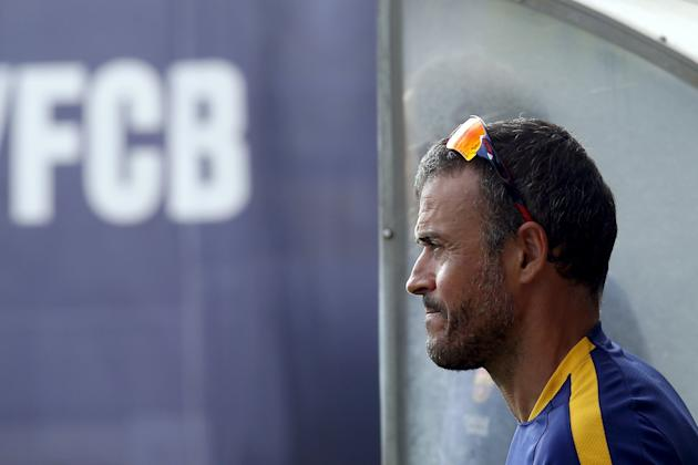 Barcelona's soccer coach Luis Enrique attends a training session at Joan Gamper training camp