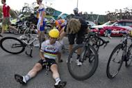 Great Britain's Mark Cavendish reacts on the ground after a crash at the end of the 214,5 km and fourth stage of the 2012 Tour de France cycling race starting in Abbeville and finishing in Rouen, northwestern France. Defending champion Cadel Evans emerged unscathed, and happy for it, after a second successive day of crash carnage at the Tour de France Wednesday