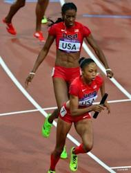 USA's Deedee Trotter (L) hands off to Allyson Felix during the women's 4X400 relay final at the athletics event of the London 2012 Olympic Games. The USA won gold