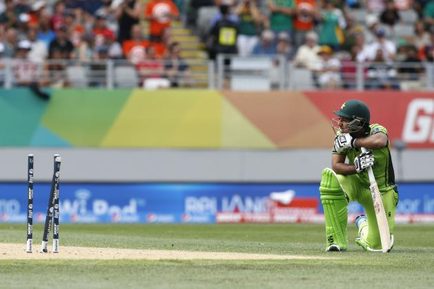 Pakistan's Ahmed looks at his shattered stumps after being run out during their Cricket World Cup match against South Africa in Auckland