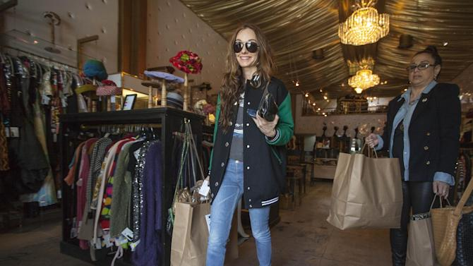 "In this photo taken Thursday, Feb. 21, 2013, interior designer and fashion designer, Kelly Wearstler shops for vintage designs at ""The Way We Wore,"" a Hollywood high-end vintage store owned by Doris Raymond in the La Brea District of Los Angeles. Raymond's vintage clothing and accessories store is featured in the reality TV series, ""L.A. Frock Stars,"" which debuts March 7, 2013 on the Smithsonian Channel. (AP Photo/Damian Dovarganes)"