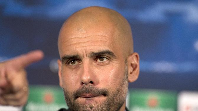 Bayern Munich's head coach Pep Guardiola listens to a question during a press conference in London, Tuesday, Feb. 18, 2014, ahead of their round of 16 Champions League soccer match against Arsenal on Wednesday