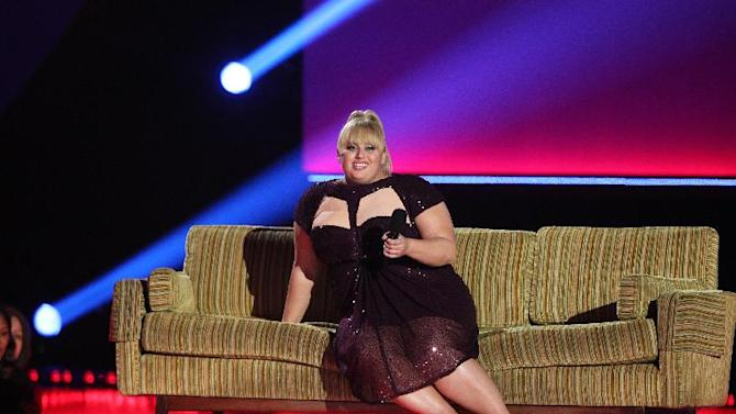 Host Rebel Wilson speaks onstage at the MTV Movie Awards in Sony Pictures Studio Lot in Culver City, Calif., on Sunday April 14, 2013. (Photo by Matt Sayles/Invision /AP)