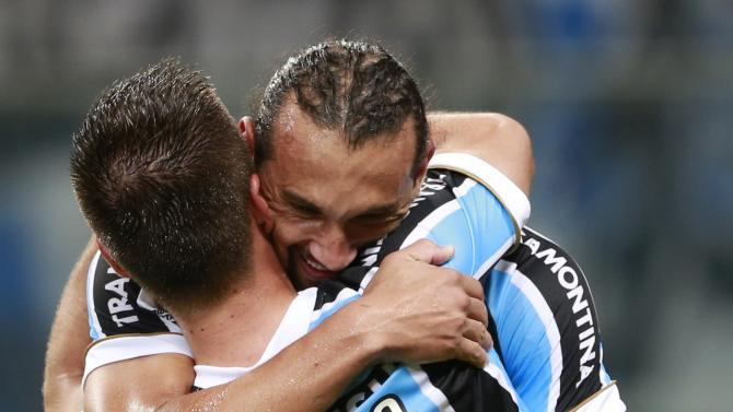 Ramiro of Brazil's Gremio celebrates with teammate Barcos after scoring a goal against Colombia's Atletico Nacional during their Copa Libertadores match in Porto Alegre