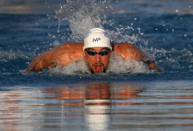 Michael Phelps competes in the men's 200-meter individual medley final, Saturday, April 18, 2015, at the Arena Pro Swim Series in Mesa, Ariz. Phelps finished in third place; Ryan Lochte won the ra