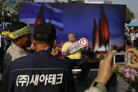 Anti-government protesters have their pictures taken inside their encampment near the Democracy monument in Bangkok January 11, 2014. REUTERS/Damir Sagolj