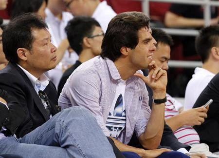 Brazilian soccer player Kaka watches a charity basketball match between the NBA All-star team and Chinese national team in Beijing July 1, 2013.