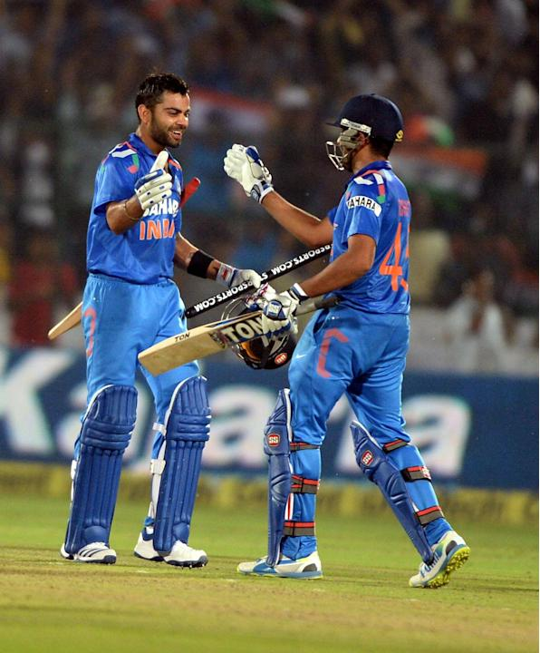 Indian players Rohit Sharma and Virat Kohli celebrates win during the 2nd ODI match between India and Australia being played at Sawai Mansingh Stadium, Jaipur on Oct. 16, 2013. (Photo: IANS)