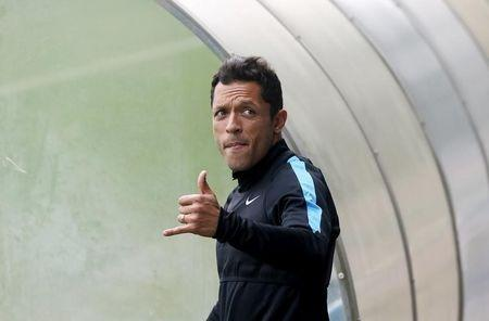 Barcelona's Adriano Correia gestures as he arrives for a training session at Joan Gamper training camp
