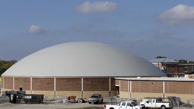 In this Thursday, Dec. 6, 2012 photo, work continues on the construction of a new domed gym at Edna High School in Edna, Texas. The hurricane dome, a structure being built in part with money from the Federal Emergency Management Agency, can be used to house first responders or residents evacuated during a storm. (AP Photo/David J. Phillip)