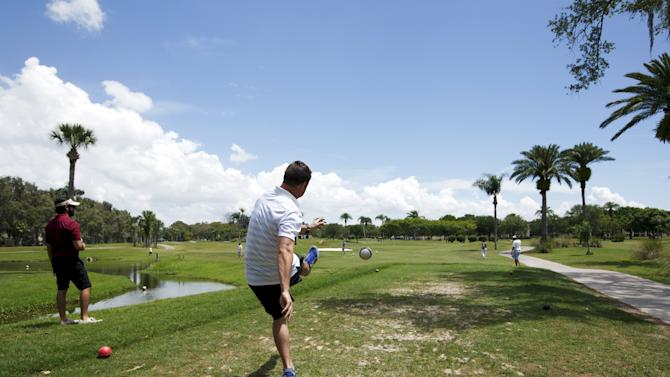 FootGolfer kicks the ball off the second tee box at Largo Golf Course in Largo, Florida
