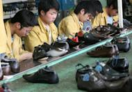 File picture of factory workers checking shoes for flaws on a production line at the Kangnai shoe factory in Wenzhou. China's leaders are sliding their toes further into the tide of economic reform, exciting ripples of cautious optimism in the United States, where Wall Street and Main Street could benefit