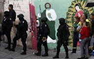 Federal police arrive at a crime scene were five youngsters were killed in Monterrey, Nuevo Leon state, on March 14, 2012. Mexico's Congress approved a bill to set up funds to compensate thousands of victims of the country's ongoing drug war