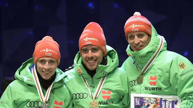 The Nordic Combined winners, (L-R) 2nd placed Eric Frenzel, winner Johannes Rydzek and 3rd Björn Kircheisen of Germany, all from Germany, during medal ceremonies of FIS Nordic World Ski Championships 2017 in Lahti