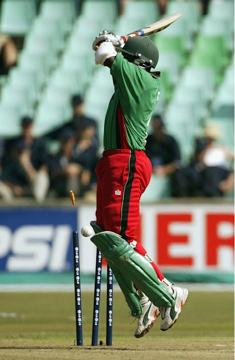 Kennedy Obuya of Kenya deflects the ball on to his wicket from a Brett Lee of Australia delivery
