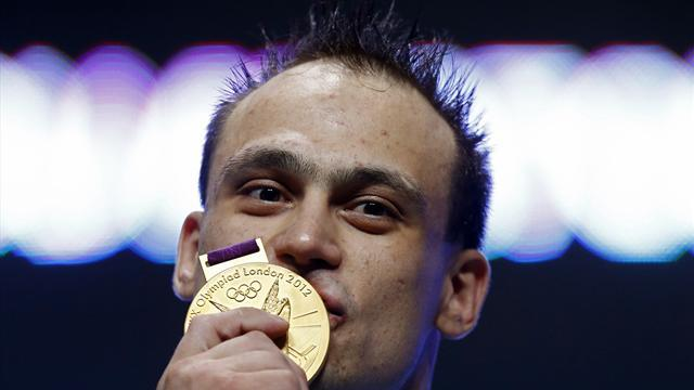 Ilyin sets two WRs en route to Olympic 94kg gold