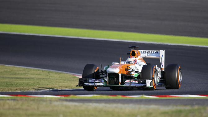 Force India Formula One driver di Resta of Britain races during the Japanese F1 Grand Prix at the Suzuka circuit