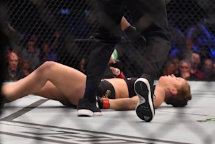 Ronda Rousey hits the canvas after being knocked out by Holly Holm. (AFP)