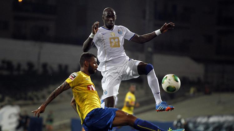 Porto's Eliaquim Mangala, top, from France, vies for the ball with Estoril's Joao Pedro Galvao, from Brazil, during their Portuguese league soccer match at the Antonio Coimbra da Mota stadium in Estoril, near Lisbon, Sunday, Sept. 22, 2013