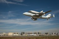 Space shuttle Endeavour, mounted atop a NASA 747 Shuttle Carrier Aircraft (SCA) performs a low flyby at Los Angeles International Airport, Friday, Sept. 21, 2012. Endeavour, built as a replacement for space shuttle Challenger, completed 25 miss