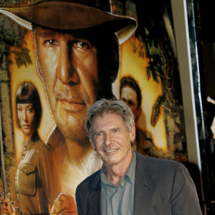 """FILE - In this June 5, 2008 file photo, actor Harrison Ford arrives for the premiere of his film """"Indiana Jones and the Kingdom of the Crystal Skull"""" in Tokyo. Ford crash-landed his vintage airplane at a Los Angeles golf course Thursday, March 5, 2015, an official said. The 72-year-old """"Star Wars"""" and """"Indiana Jones"""" actor is an aviation enthusiast who often flies out of the Santa Monica Airport.  He suffered moderate injuries and was taken to a hospital. (AP Photo/Shizuo Kambayashi, File)"""
