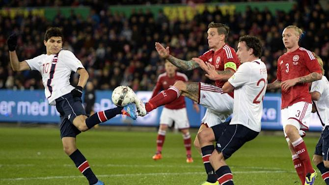 Norway's Tarik Elyounoussi, left, and Vegard Forren, second right, try to take the ball away from Denmark's Daniel Agger, center, during their international friendly match in Herning, Denmark, Friday, Nov. 15. 2013