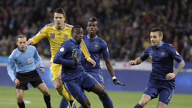 France's Blaise Matuidi, center, and Mathieu Debuchy, right, challenges for the ball with Yevhen Konoplyanka of Ukraine, second left, during their 2014 World Cup qualifying playoff first leg soccer match at the Olympiyskiy national stadium in Kiev, Ukraine, Friday, Nov. 15, 2013