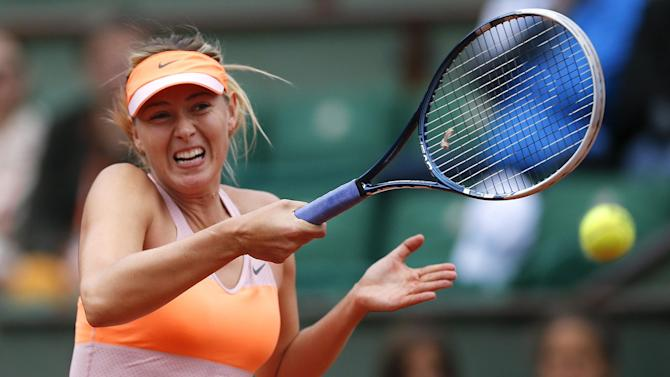 Tennis - Sharapova lives to fight another day, Gulbis powers on