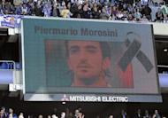 People observe a moment of silence for Italian footballer Piermario Morosini before the Spanish league football match between RCD Espanyol and Valencia CF at the Cornella-El Prat stadium in Cornella on April 15. Six hours of autopsy on Monday failed to produce an answer as to what caused the death of Livorno footballer Morosini, who collapsed and died during a match on Saturday